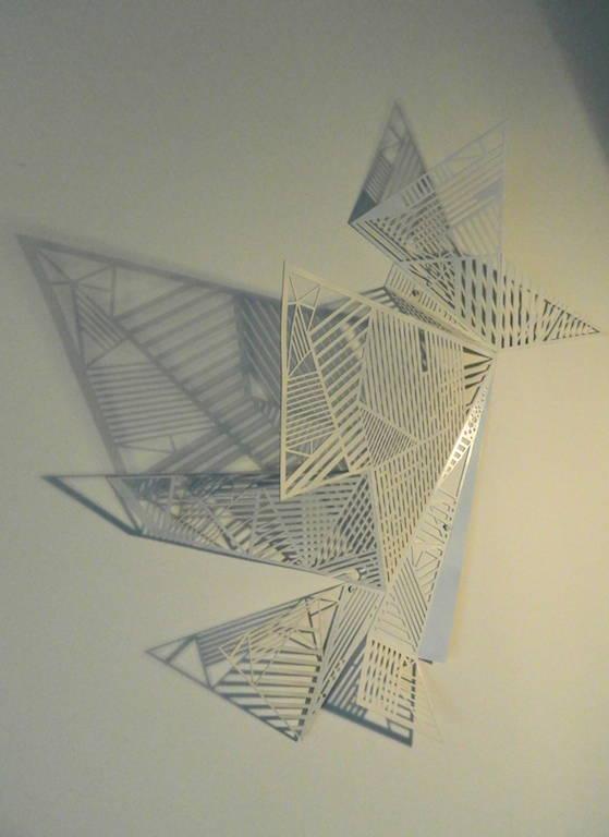 Giochi di ombre. Lampada da parete di Alessandra Meacci