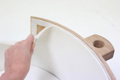 Lusi, la culla in legno a dondolo